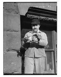 Rat Catcher Holding Ferret, Photograph N... by Library of Congress