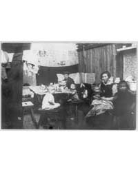 Family in Crowded Living Quarters in Ess... by Library of Congress