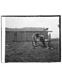 Cannon and Cabin at Chickamauga and Chat... by Library of Congress