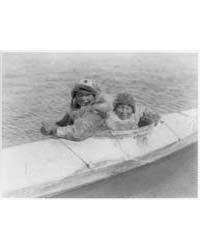 Boys in a Kaiak I.E., Kayak--nunivak by Curtis, Edward S.
