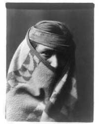 A Navaho with Blanket Wrapped Around Hea... by Curtis, Edward S.