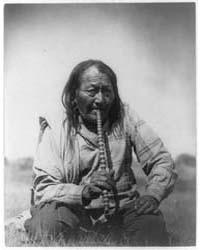 Arapaho Indian Smoking Pipe by Curtis, Edward S.