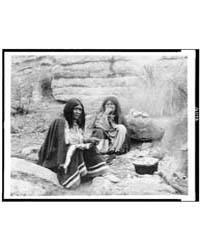 Two Apache Indian Women at Campfire, Coo... by Curtis, Edward S.