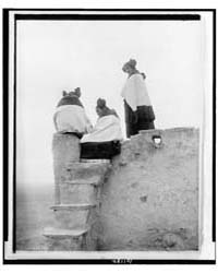 Three Hopi Women at Top of Adobe Steps, ... by Curtis, Edward S.