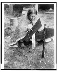 Preparing Cedar Bark--nakoaktok by Curtis, Edward S.