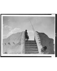 Tewa Indian Guard at Top of the Kiva Sta... by Curtis, Edward S.
