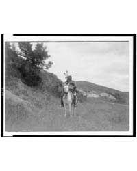 Sioux Indian on Horseback, Wearing Two F... by Curtis, Edward S.