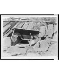 Entrance to a Yurok Sweat-house by Curtis, Edward S.