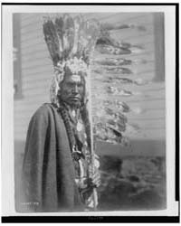 Piegan War-bonnet and Coup-stick by Curtis, Edward S.
