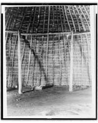 Interior of Wichita Grass-house by Curtis, Edward S.