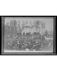 Crowd at Ceremony Next to Tower with Fla... by Library of Congress
