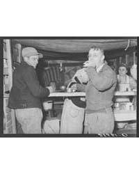 Farmer at Lunch Stand Cornhusking Contes... by Library of Congress
