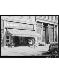 Store on Main Street Grundy Center, Iowa... by Library of Congress