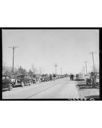 Farmer's Cars Line the Highway Near Zimm... by Library of Congress