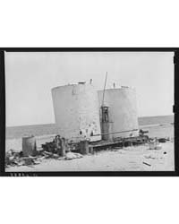 Gasoline Storage Tanks on 4900 Acre Farm... by Library of Congress