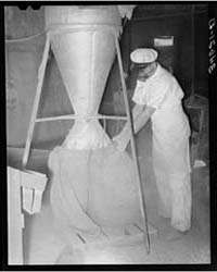 Proprietor of Feed Mill Holding Sack Int... by Library of Congress