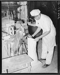 Proprietor of Feed Mill Filling Sack wit... by Library of Congress