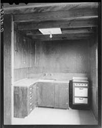 Kitchen in the Multi-family Unit for Per... by Library of Congress