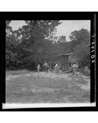 Noontime Chores on Negro Tenant Farm the... by Library of Congress