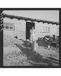 Mrs Dougherty in Doorway of Basement Hou... by Library of Congress