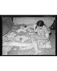 White Migrant Mother Piecing a Quilt Har... by Library of Congress