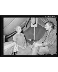 White Migrant and His Wife in Camp Near ... by Library of Congress