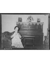 Wife of Joseph La Blanc Crocheting in Li... by Library of Congress