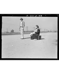Young Family, Penniless, Hitchhiking on ... by Library of Congress