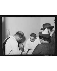 Doctors Examining Baby Whose Parents Hav... by Library of Congress