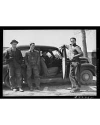 These Men Stopped at a Trailer Settlemen... by Library of Congress