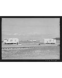 Prefabricated Houses Being Built Near Pa... by Library of Congress