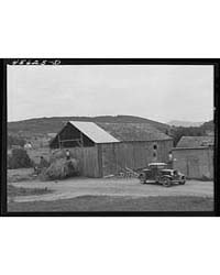 Using a Car to Load Hay in the Barn on a... by Library of Congress