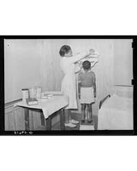 Child Being Weighed and Examined in Heal... by Library of Congress