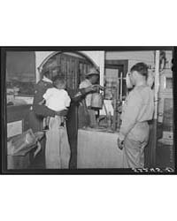 Tenant Buying Kerosene in Plantation Sto... by Library of Congress