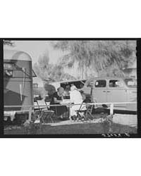 Guests of Trailer Park Playing Chinese C... by Library of Congress