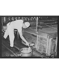 Draining Off the Whey in Making Cheese a... by Library of Congress