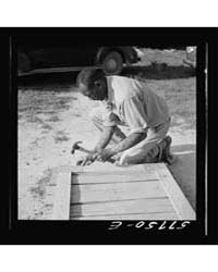 Assembling a Joint of Screen Door Screen... by Library of Congress