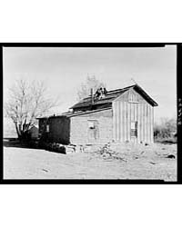 Farmer and Wife Shingling Roof of Farmho... by Library of Congress