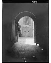 View of a Courtyard Through an Arched Pa... by Genthe, Arnold