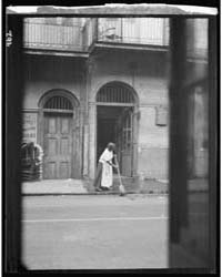 View from Across Street of a Woman Clean... by Genthe, Arnold
