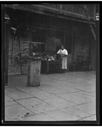 Woman Working in a Courtyard, New Orlean... by Genthe, Arnold