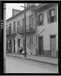 View from Across Street of Four People T... by Genthe, Arnold