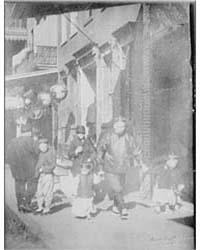 Man and Two Boys Walking Along a Street,... by Genthe, Arnold