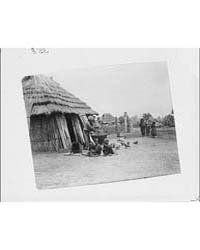 Ainu Women and Children Outside a Hut, P... by Genthe, Arnold