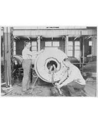 Three Men Working on Large Gun in Naval ... by Johnston, Frances Benjamin