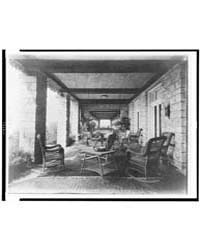 Porch of E.C. Converse House, with Wicke... by Johnston, Frances Benjamin