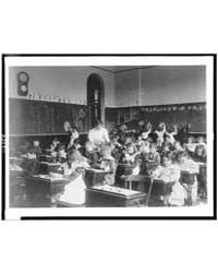 Children Modeling Clay at Desks and Draw... by Johnston, Frances Benjamin