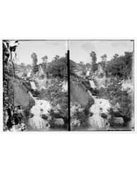 Stream Flowing Amid Rocks and Plants, Ph... by Library of Congress