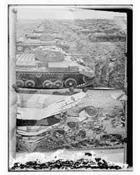 Copy Photograph of Tanks and Soldiers To... by Library of Congress