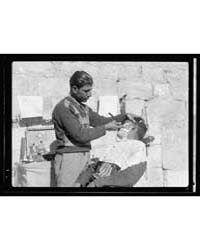 Street Barber, Photograph 17139V by American Colony Jerusalem